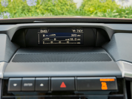 An LCD screen provided vehicle operational data, including fuel economy,