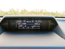 Driving and trip data appears on a dashboard-mounted non-color screen.