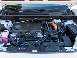The RAV Hybrid's 2.5L four-cylinder engine and electric motor send power to through a CVT to an...