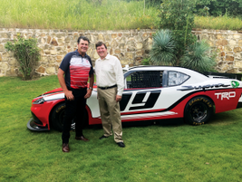 Michael Waltrip, Hall of Fame NASCAR driver (L), poses with Mark Oldenburg, sr. manager fleet...