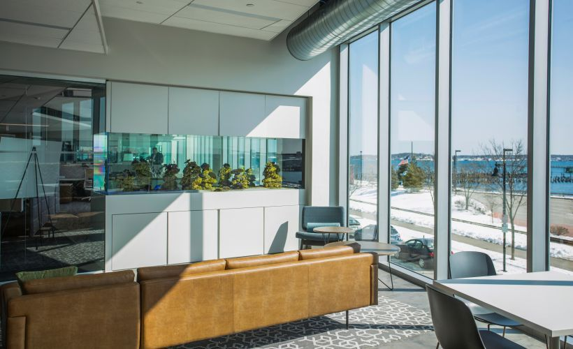 The new headquarters included an aquarium that's expected to be a hub for associates.
