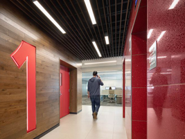 WEX Red is a prominent feature throughout the building, including the elevator bays.