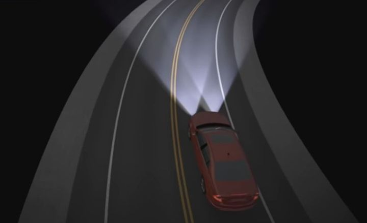 Adaptive headlight systems allow drivers to spot a difficult-to-see object on a dark, curvy road about a third of a second earlier than they would with conventional headlights.  - Screenshot via IIHS.