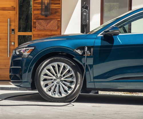 Photo Courtesy of Audi of America. 2019 model shown. The Audi e-tron can be charged at home, and is designed to be compatible with public DC fast chargers1. -