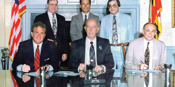 Back row (L-R): Sen. Laurence Levitan, chair, Budget and Taxation Committee; Michael DeLorenzo,...