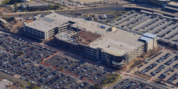 This aerial view shows the construction of the consolidated car rental facility at...