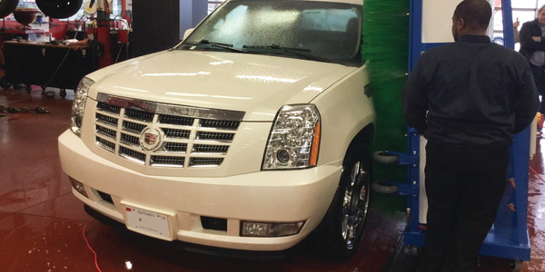 Awash System Corp.'s portable car wash uses only three gallons of water to wash a car. Photo...