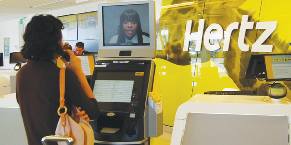 The rental counter is replaced by a concierge and kiosk system in which customers can access a...