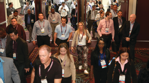 Attendees head into the show's exhibit hall. There were several opportunities for attendees to...