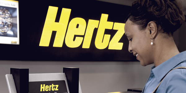 Hertz's home-based agent program and ExpressRent kiosk initiatives are decentralizing the...