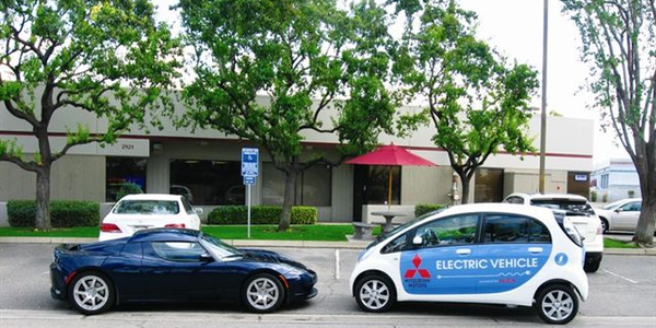 A Tesla Roadster meets a Mitsubishi i-MiEV outside the Eckhaus Fleet offices in Clovis, Calif.