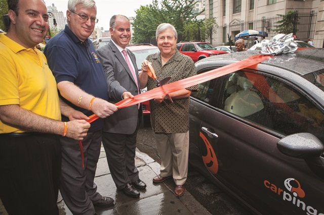 Marty Markowitz, Brooklyn borough president, cuts the ribbon to launch Carpingo. Looking on (right to left) is Gil Cygler, Carpingo CEO, Assemblyman Alan Maisel and Carlo Scissura, Brooklyn Chamber of Commerce president. In an Aug. 15 press statement, Markowitz estimated that Carpingo's services will bring more than half a million dollars into the Brooklyn economy in the company's first year.