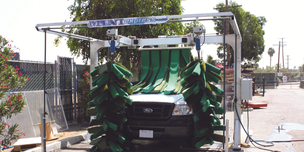 The mini express car wash system from NS Wash takes up less space and produces less water than a...