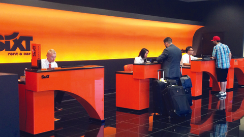 Employees help customers at Sixt's new franchise in Las Vegas.