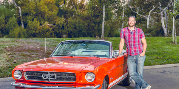 Pierre Lapointe, CEO and co-founder of Vinty, poses with a Ford Mustang convertible. Photo...