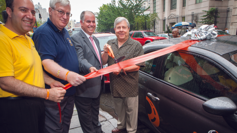 Marty Markowitz, Brooklyn borough president, cuts the ribbon to launch Carpingo. Looking on...