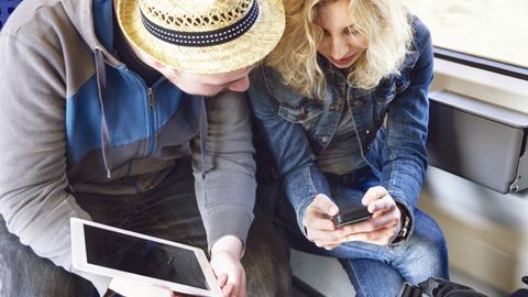 Could these travelers be using technology to shop car rental rates just minutes before picking...