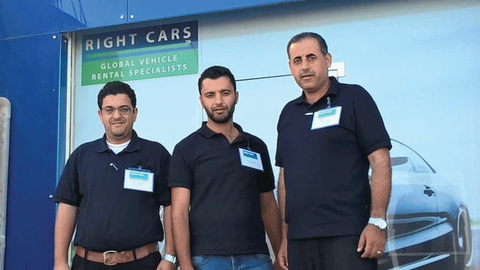 The Right Cars service team from Jordan anchors a trade booth. Photo courtesy of Right Cars.
