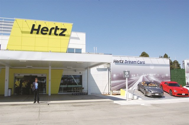 "The redesign of the Hertz facilities, such as the San Diego airport location, includes ""Wow"" ramps featuring luxury and sport rental models."