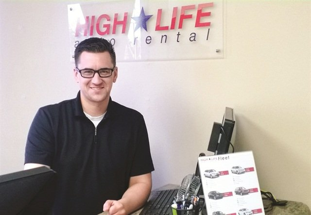 Cole Randall, one of the owners of High Life Auto Rental, stands behind the counter of High Life's recently opened location at AutoNation Ford of Scottsdale. High Life handles all of the dealership's replacement rentals.