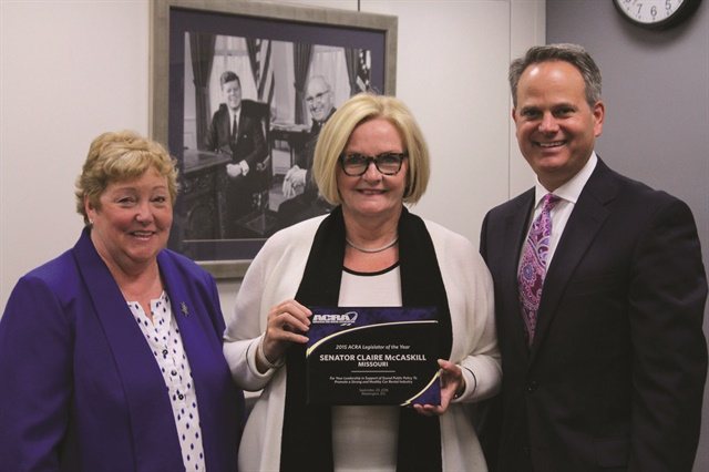 "Sharon Faulkner (left) and Gordon Reel, assistant vice president of government and public affairs at Enterprise Holdings, present Sen. Claire McCaskill (D-Mo.) with one of two ACRA Legislator of the Year Awards. ""Senator McCaskill was a leader in the process that produced the compromise between the consumer groups and the rental car industry on the ACRA-supported Safe Rental Car Act,"" said Reel."