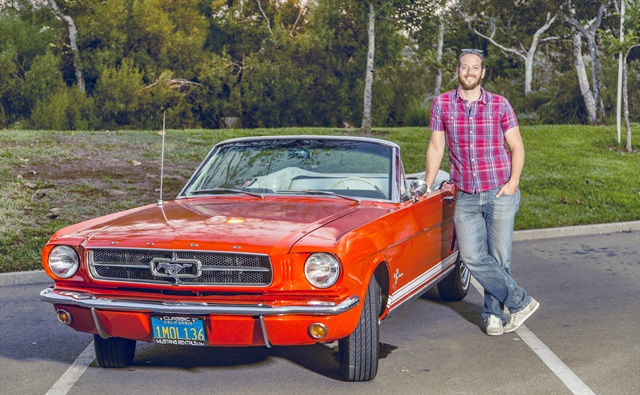 Pierre Lapointe, CEO and co-founder of Vinty, poses with a Ford Mustang convertible. Photo courtesy of Vinty
