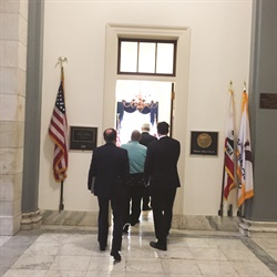 "The ""West"" delegation enters the offices of Rep. Nancy Pelosi, the minority leader of the House of Representatives."