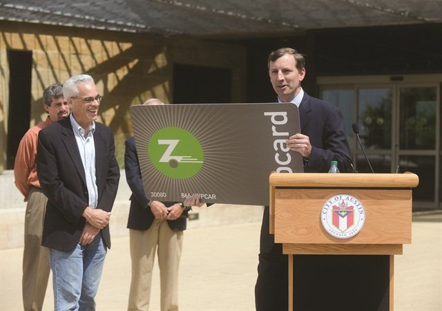Mark Norman, president of Zipcar, announces the launch of Zipcar's car sharing in the City of Austin in April 2012. Zipcar's recent merger with Avis Budget Group has helped it gain more buying power, breadth of scale and a greater global network.