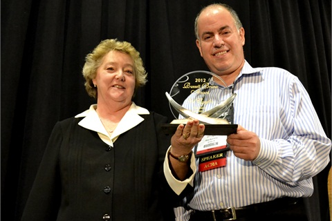 Gil Cygler (right), president of Allcar Rent A Car, is this year's winner of the Russell Bruno award. The award was presented this year by ACRA Executive Director Sharon Faulkner.