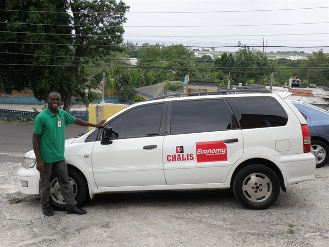 A Chalis Car Rental & Tours employee, Barry, picks up customers from the airport in this courtesy van.
