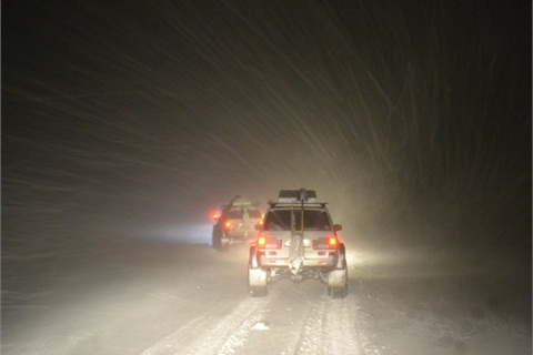 A night drive in Iceland with snow drift.