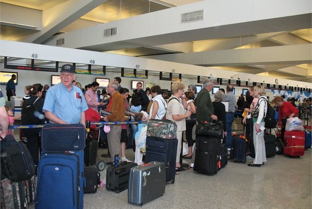 In this file photo, customers wait at Atlanta's Hartsfield-Jackson International Airport. (Photo via flickr courtesy of James Emery.)