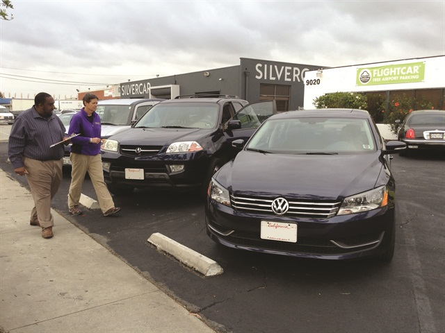 A FlightCar manager escorts a customer to a car at its LAX location. Photo credit: FlightCar