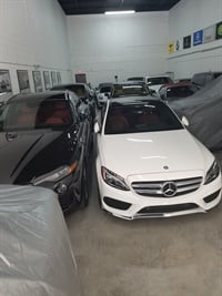 Bruno Vargas, owner of Speed Luxury Car Rental in Miami, parked his luxury rental vehicles inside his facillity in Miami during Hurricane Irma. Photo courtesy of Bruno Vargas