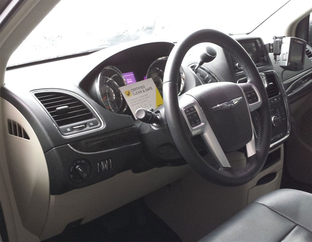 Once a vehicle has been inspected, Hertz puts a signed card from the Certified Clean & Safe Program on the vehicle's steering column. Photo credit: The Hertz Corp.