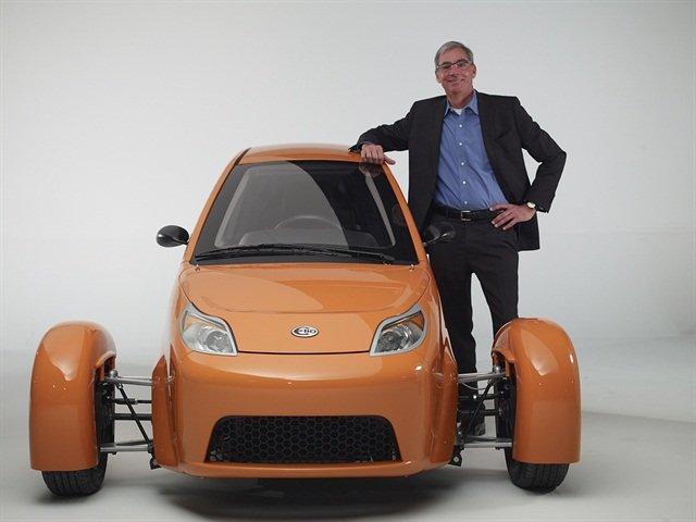 Owner Paul Elio stands next to Elio Motors' new three-wheeled vehicle. Photo courtesy of Elio Motors.