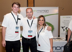 Richard Lowden (center) pictured with two employees at the Green Motion booth at the 2015 Auto Rental Summit. Photo by Joe Cancellare.