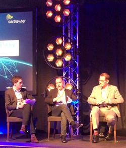 Richard Lowden (center), CEO and founder of Green Motion, serves as a panelist in a session at CarTrawler's 2017 Winter Conference. Photo courtesy of Green Motion.
