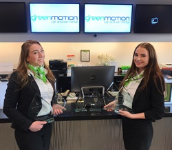 Employees at San Diego's Green Motion franchise location hold the award trophies. Photo courtesy of Green Motion.
