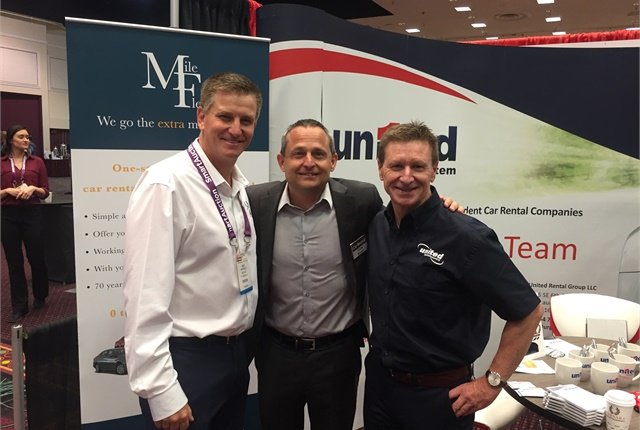 Mike Muehlenfeld, left, Auto Rental News Executive Chris Brown, center, and Ian Lawrence, right, at the 2018 International Car Rental Show.