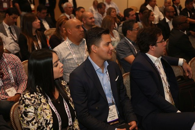 Attendees listen to a session at last year's Latin America Meeting. Photo by Steve Reed