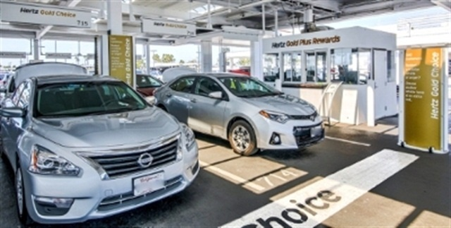 Vehicles at Hertz's Gold Plus Rewards Program section. Photo courtesy of The Hertz Corp.