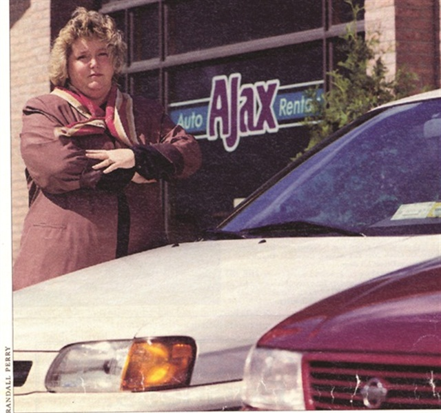 Sharon Faulkner in front of Ajax Auto Rental franchise in Albany, N.Y.