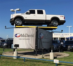 360 Auto Display's spinning vehicle platform. It elevates a vehicle 10 feet in the air. Photo courtesy of 360 Auto Display.