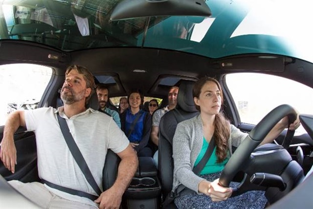 One of Green Commuter's Tesla Model X vehicles vanpooling with seven passengers. Photo courtesy of Green Commuter.