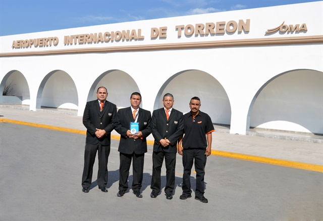 The Sixt Mexico team at Torreon Airport holds up its Rentalcars.com award. Photo courtesy of Sixt Mexico
