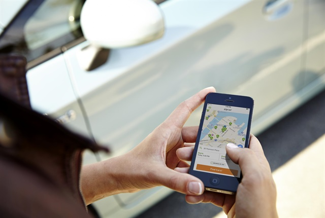 A Zipcar customer uses the mobile app to locate a vehicle. Photo courtesy of Zipcar.