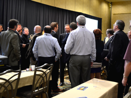 A line of attendees wait to speak with Mark Frissora and Gary Rappeport about their address on...