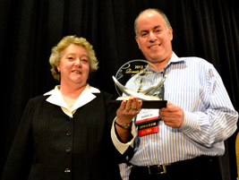 Gil Cygler (right), president of Allcar Rent A Car, is this year's winner of the Russell Bruno...