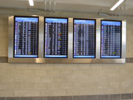 The facility features screens with flight arrivals and departures times.